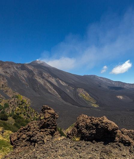 Trekking on the volcanic sand in the Valle del Bove
